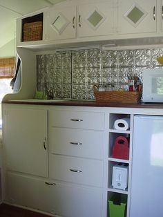how i want the cabinets in my camper, with just a sink and count to put my camp stove on if need and my microfridge. Also love the ceiling tiles on back