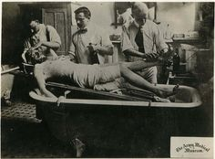 Bathing a severely wounded solider upon arrival at Walter Reed General Hospital, 1915.  National Museum of Health and Medicine