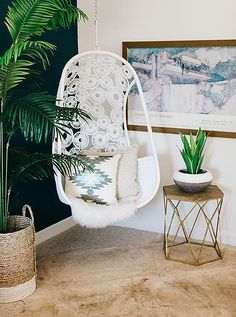 Who said hanging chairs always have to be hung outside? We love the urban jungle feel it gives to this cozy bedroom corner.