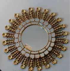 Large Vintage starburst mirror from Caught My Fancy on theredvault.com