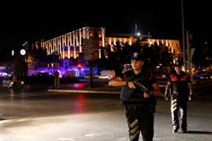 Police officers stand guard near the Turkish military headquarters in Ankara, Turkey