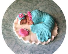 Mermaid baby shower fondant cake topper! CREATE A BEAUTIFUL CAKE AT HOME••• Our fondant cake toppers make designing your own special cake super easy! Choose one on our site and personalize it to your colors or have one made just for you! Fondant Cake Toppers, Fondant Baby, Fondant Figures, Mermaid Baby Showers, Baby Mermaid, Christening Cake Boy, Tutu Cakes, Princess Cake Toppers, Girly Cakes