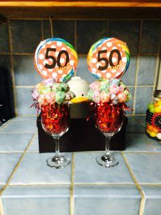 50 Sucks dumb dumb sucker bouquet using wine glasses Sucker Bouquet, Suckers, 50th, Cake Pops, Cake Pop, Cakepops