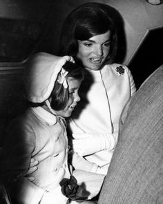 Caroline Kennedy, Jacqueline Kennedy, leave for Idlewild Airport for a vacation to Rome for two weeks.