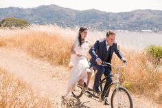 The bride and groom coast the hills on a bicycle built for two! Juniper Spring Photography.