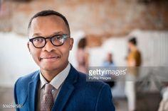 Photo : Confident businessman at creative office #ManPortrait