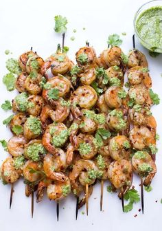 Garlic Shrimp Skewers with Cilantro Pesto - A super quick and easy meal! All clean eating ingredients are used for this healthy shrimp recipe. Pin now to make next time you crave seafood! Fish Dishes, Seafood Dishes, Fish And Seafood, Seafood Recipes, Dinner Recipes, Cooking Recipes, Healthy Recipes, Smoker Recipes, Rib Recipes