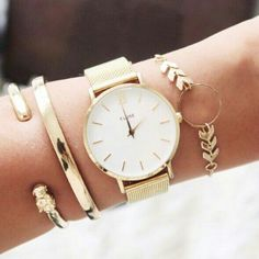 Simple arm candy. Especially a fashion watch and bangles-- Charming Charlie, Target, Marshalls, TJMaxx, JCPennys, Macys