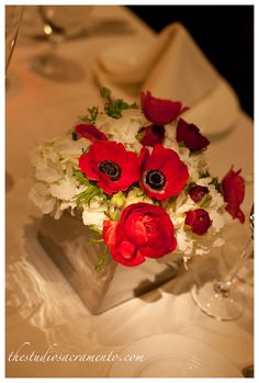nnot the same flower types, but an example of a red & white arrangement in a glass cube.