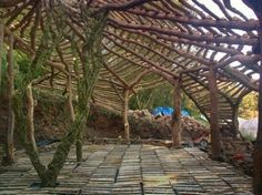 He is building the first home in the Lammas Village project, with the design similar to the hobbit house. Description from shaman-australis.com. I searched for this on bing.com/images