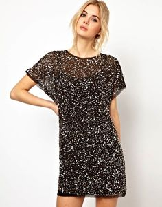 Love this dress and all its sparkles! Reminds me of my sparkly shirt. This one needs some jewelry accompaniment and more color added somewhere in the look.