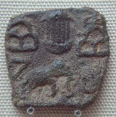 Pandyan Chola coin depicting a temple between hill symbols and elephant, Pandyas, Sri Lanka, 1st century CE.