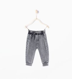 Image 1 of Faded effect trousers from Zara