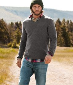 Gray V-neck sweater over plaid shirt…