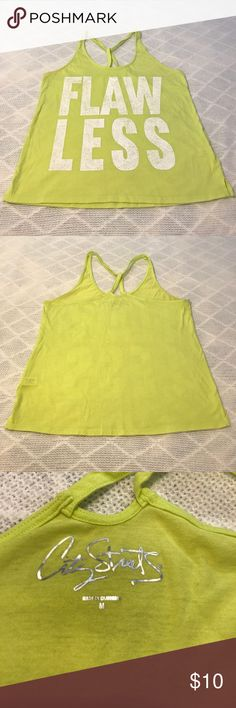 """Yellow & White Graphic Workout Tank Top Flawless graphic tank. Gently-worn. Excellent used condition. Back is racerback style. Small slit design on sides. Measurements (approximate): 18"""" armpit to armpit; 23.5"""" top of strap to bottom hem. Flaws: minimal piling throughout, faint red mark & tiny pull on bottom backside (last pic), so small it's hard to see in photograph. Bundle to save! City Streets Tops Tank Tops"""