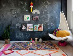 Create a space to let their imaginations run wild! styles our bold and bright Saffi rug and Cloud cushion against a chalk wall - so cute and creative! Looking at this wall in 's room never gets old. Blackboard Wall, Chalk Wall, Chalkboard Wallpaper, Lorena Canals Rugs, Down Syndrome Kids, Cloud Cushion, Chill Room, Beautiful Family, Kid Spaces