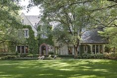 The stone manor, built in 1925, features a distinctly English aesthetic, from the gardens to the interiors (gorgeous -- LOVE)