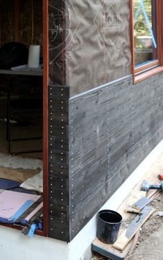 Dwell Home Venice. end joints ebony stained cedar + galvanized screws. brass in mock-up