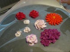 If you need to make lots of frosting flowers (such as for decorating a wedding cake), you can make many of the flowers ahead of time and then let them air dry before putting them on your cake. This video shows you how to make hydrangeas, gardenias, roses and Gerber daisies out of buttercream frosting.