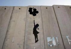 "A graffiti titled ""Balloon Debate"" made by Banksy is seen on Israel's highly controversial West Bank barrier in Ramallah on August 6, 2005."