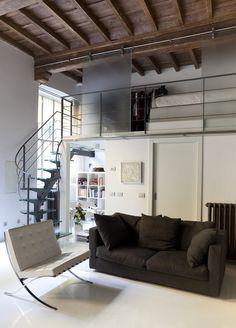 atico con techo abovedado con diseño moderno