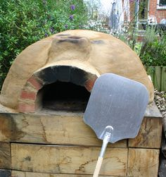 A Backyard Bread Oven ~ They can be used to cook just about anything, but they do take a while to heat up. From rustic pizzas, slow-roasted meats and vegetables, to artisan breads, a clay or brick outdoor oven is a great way to cook outside without heating up the house and really exemplifies slow food.