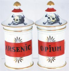 PAIR OF DRUG JARS. 6ins tall to top of lids, gold highlights, black lettering, red/ orange paint