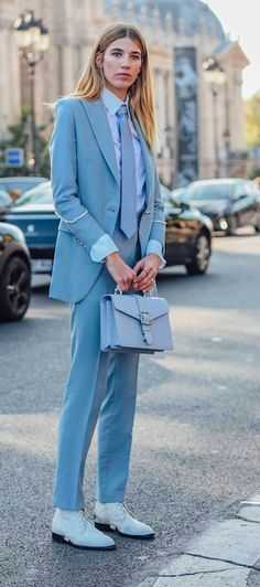 The Vogue Edit. Veronika Heilbrunner borrowed from the boys at Paris Fashion Week SS17 in a powder blue Brioni suit with bright white boots.