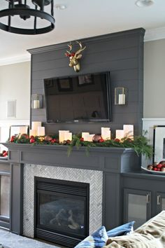 Take your home's fireplaces into the next level by designing an indoor fireplace makeover. What you need is a personalized fireplace design for your home. It is the perfect way to give your home a new, streamlined look. Tv Over Fireplace, Grey Fireplace, Simple Fireplace, Christmas Fireplace, Home Fireplace, Fireplace Remodel, Christmas Mantels, Fireplace Surrounds, Fireplace Design