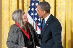 President Obama presents a National Humanities Medal to Marilynne Robinson during a ceremony at the White House in 2013.