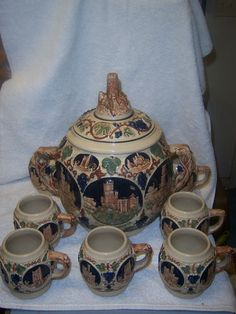 German punch bowl and mugs, decorated with various fortress castles or their ruins.  I have this set.......