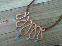 Handmade wire copper necklace with turquoise stones