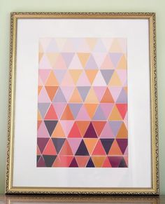 Pin for Later: 33 Awesome Ways to Upcycle Paint Chips Paint Chip Triangle Art Cut paint chips into triangles, and piece them together for a beautiful art piece.  Source: The Lovely Cupboard