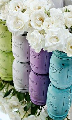 Lavender, turquoise pewter and soft grass green sprayed Ball jars with white roses.