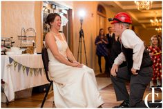 Fall wedding in Muscatine, Iowa at the Rendezvous Banquet Hall. Photography by Emily Crall. Garter toss.