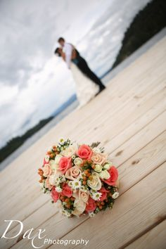 Coral wedding bouquet & great pic