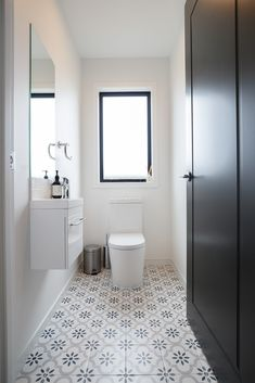 A beautifully decorated powder room offering a sense of style and calm. #interiordesign #powderroom #floortiles #showhome #riverheadshowhome #coatesvilleplan #generationhomesnz Powder Room, Toilet, Bathrooms, Calm, Flooring, Interior Design, Stylish, Home, Nest Design