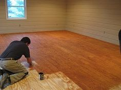 Plywood cute in planks, nailed down, sanded, stained and sealed.  A third of the cost of hardwood floors.  Great budget friendly option to hard wood floors.  Looks great - check out this site This would be great for a basement makeover
