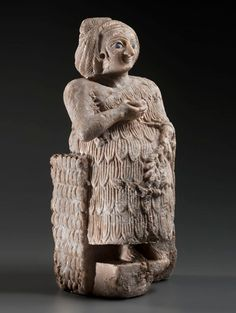"""Sumerian Statuette of a Smiling Worshiper, Early Dynastic III, c. 2800-2550 BCThe statuette is made of Alabaster, bitumen, lapis lazuli and possibly shell. The woman's expression, almost """"smiling"""", is a distinctive feature of Mesopotamian figures; in..."""