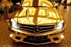 Gold Plated Mercedes Benz! Heck yah, if I was rich! You would need 4 body guards just for you car!