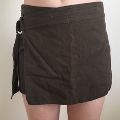 H&M faux wrap skirt H&M lyocell faux wrap skort. Has side zip entry and a D ring wrap closure. Fits small. Pairs best with a tank and gladiator sandals  H&M Shorts Skorts