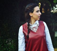 statement silver necklace and faux leather top marsala