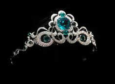 By Ernesto Moreira, Houston, TX 2005:   Platinum tiara with (42.4 carats) large center emerald, (7.56 carats) side emeralds, and (7.89 carats) of pave diamonds.