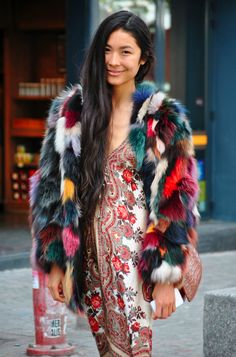 Multi-colored faux fur jacket over print dress. Wonderful! (Boho look) Dare to do it? Here are my tips on how to wear prints: http://dresslikeaparisian.com/how-to-wear-prints-3/