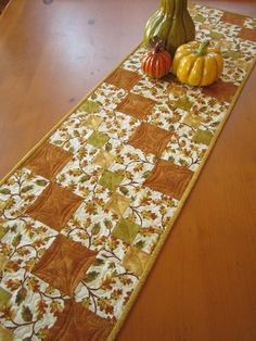 It's time to decorate your table for Fall and this table runner would looking stunning. The main fabric has oak leaves with yellow, green and gold to complement