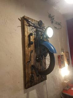 "Wall Lamps Made with Recycled Motorbike Parts Amazing wall lamps made with recycled motorbike parts by French designer GOGUS ""Bike to Life"" show.Amazing wall lamps made with recycled motorbike parts by French designer GOGUS ""Bike to Life"" show."