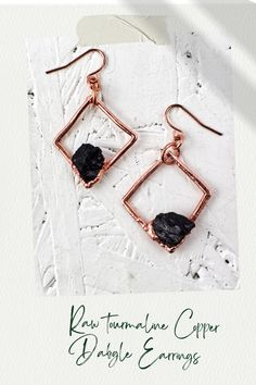 These unique handmade copper dangles feature Black Tourmaline. This healing stone is of purification, cleansing the emotional body of negative thoughts, anxieties, anger or feelings of unworthiness. Birthstone of October! Earrings are on copper wire hooks with clear plastic backings.