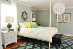 Wooden floors in the bedroom? Add a rug to soften it up.