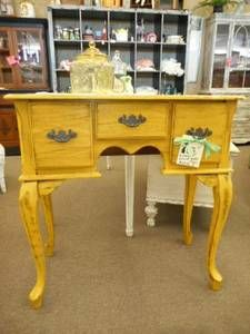 $109 - Distressed entry table with 3 drawers - painted a sunshine yellow, distressed and finished in a dark wax. ***** In Booth A8 at Main Street Antique Mall 7260 E Main St (east of Power RD on MAIN STREET) Mesa Az 85207 **** Open 7 days a week 10:00AM-5:30PM **** Call for more information 480 924 1122 **** We Accept cash, debit, VISA, Mastercard, Discover or American Express