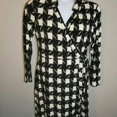 Beautiful Black Cream Dress This abstract print dress features long sleeves, a wrapped hem and a classic fit. Never been worn, brand new. Dresses Long Sleeve